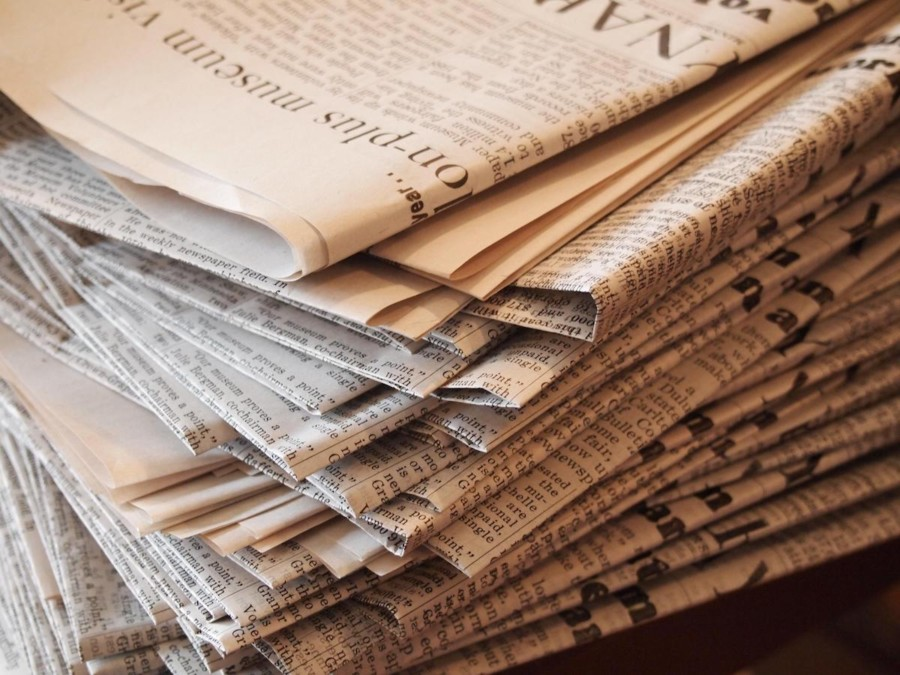 Press freedom Media House International Reporters Sans Frontieres – photo of a stack of newspapers