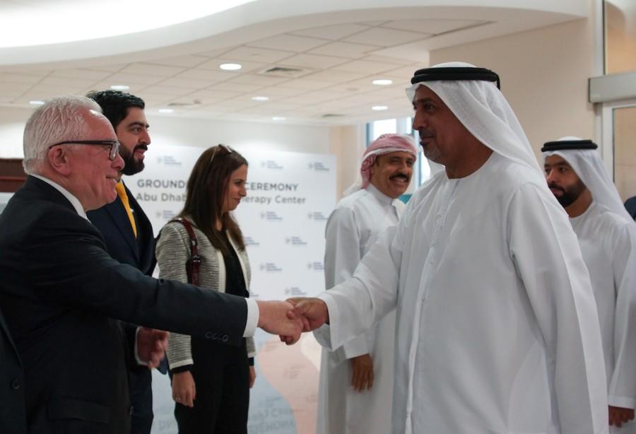 Jack Irvine shakes the hand of Sheikh Dr Sultan Bin Khalifa Bin Zayed Al Nahyan in Abu Dhabi