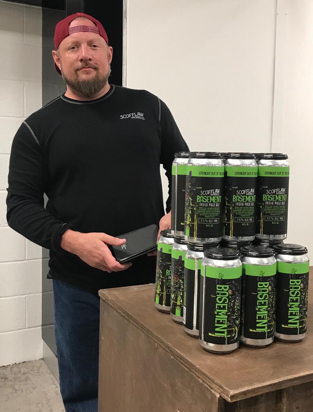 Matt Shirah Scofflaw stands beside his famed Basement IPA craft beer