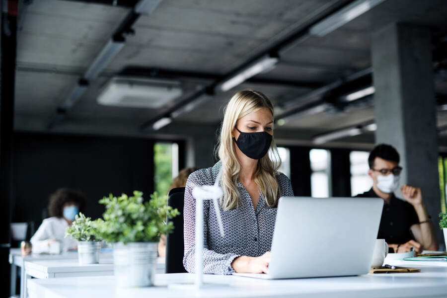 Office worker wearing face covering COVID – corporate PR